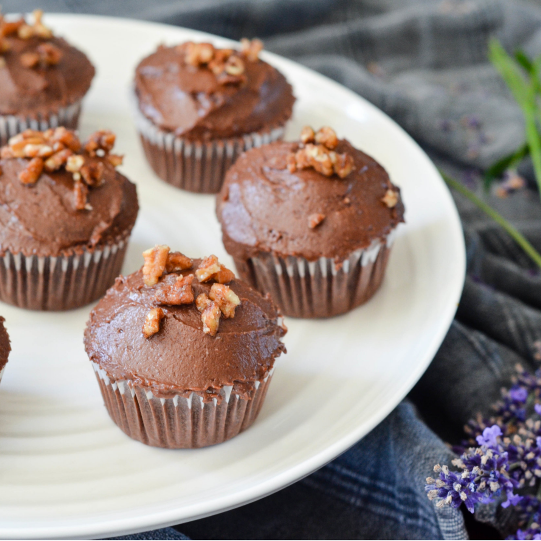 Decadent Dark Chocolate Cupcakes with Chocolate Fudge Icing and A Praline Topping